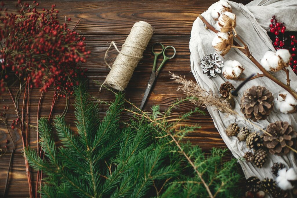 Christmas tree branches and decorations for making rustic christmas wreath at home